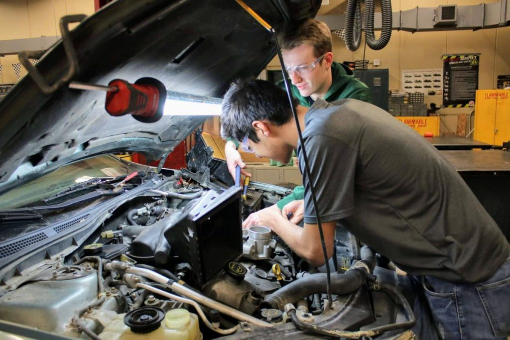 Picture of Jefferson High School students working on a car.