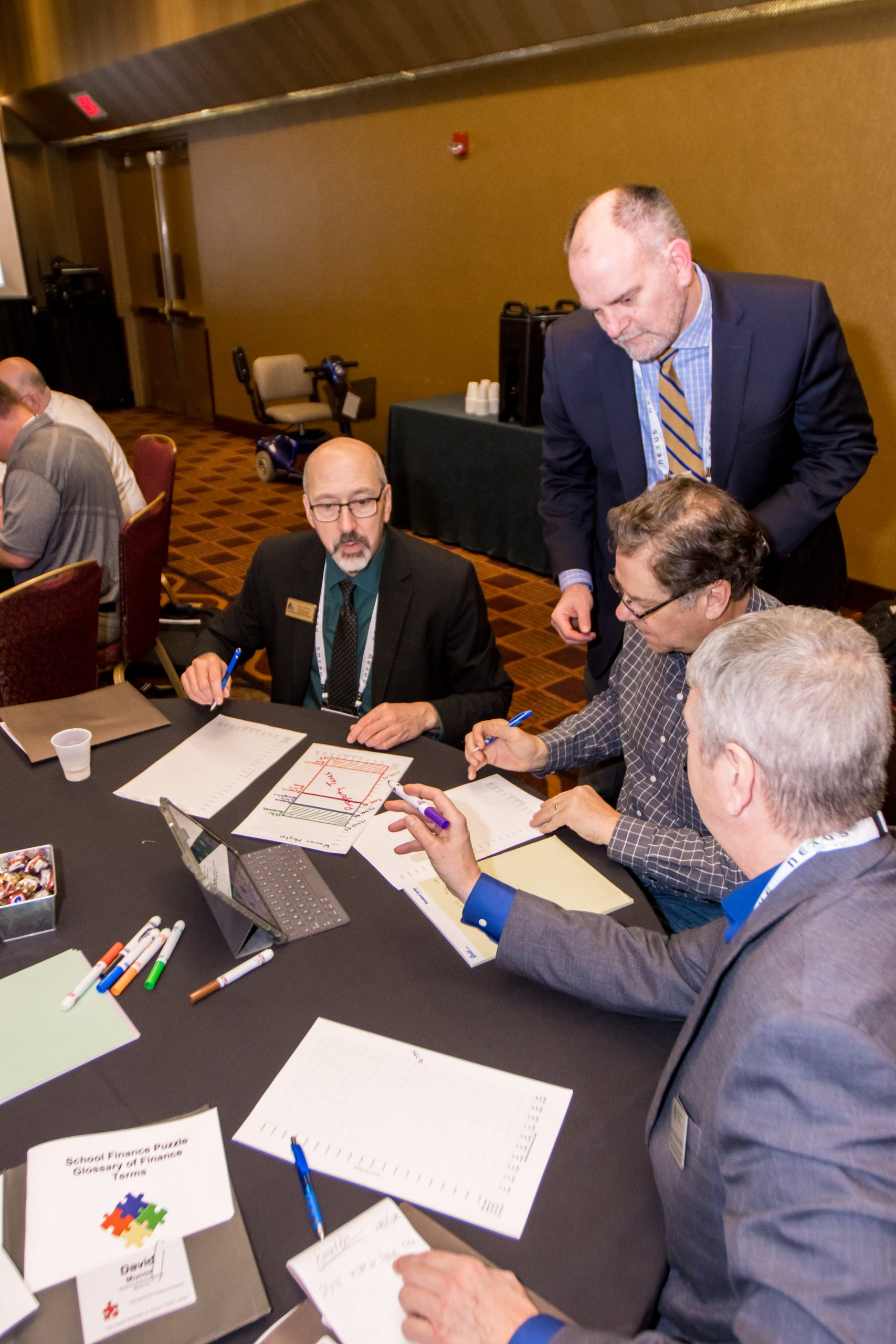 Attendees of a pre-convention workshop conduct an activity.