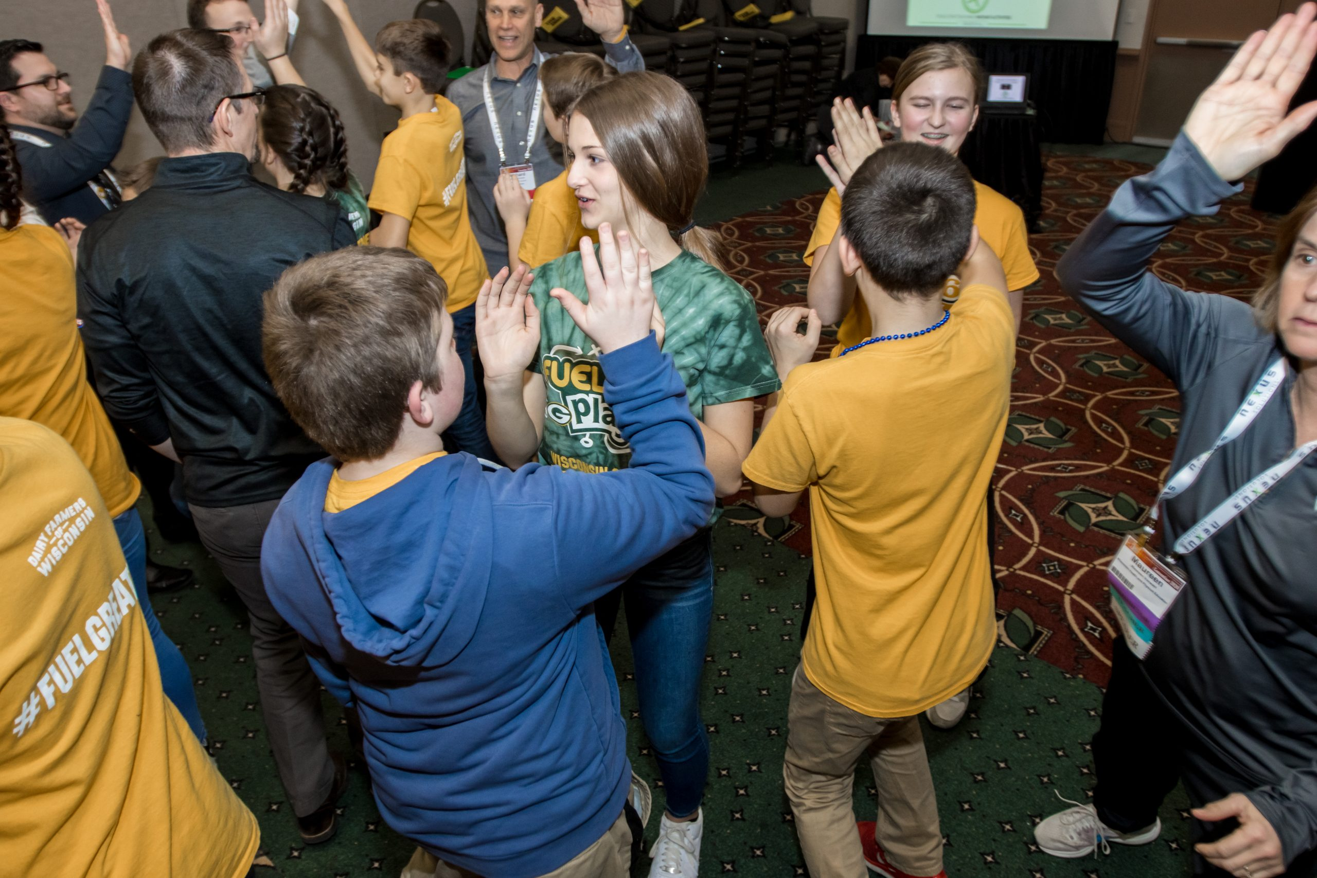 Students high five one another at the State Education Convention.