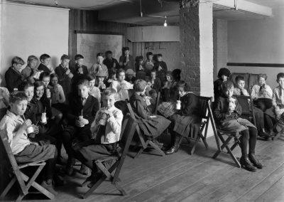 Kids drinking milk in Washington School in Madison in 1921.